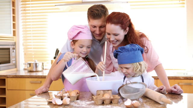 family making a cake - chef's hat stock videos & royalty-free footage