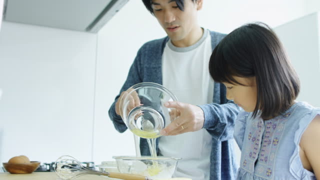 Family Making Cake at Home