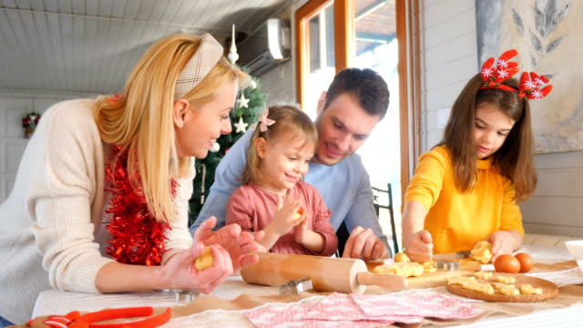 family making christmas cookies together - moulding trim stock videos & royalty-free footage