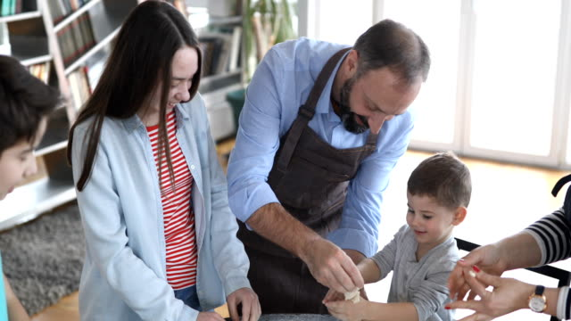 family making cookies at home - biscuit stock videos & royalty-free footage