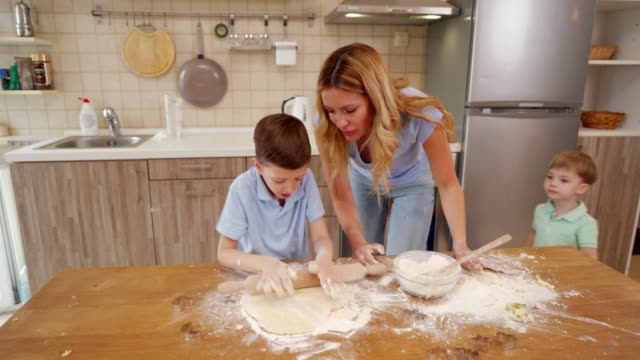 family making cookies together - rolling pin stock videos & royalty-free footage