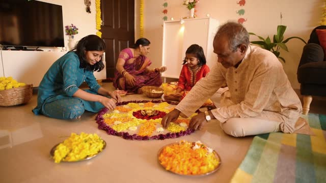 family making rangoli from flower petals - decoration stock videos & royalty-free footage