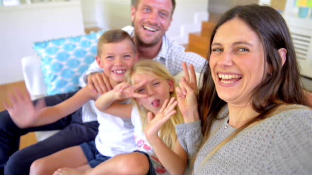 selfie: family making selfie video - young family stock videos & royalty-free footage