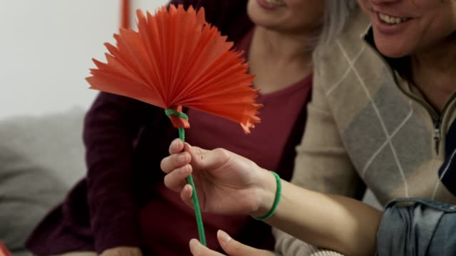 family making traditional chinese new year decorations - 65 69 years stock videos & royalty-free footage