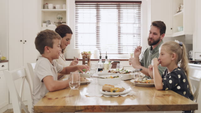family meals are the most delicious of them all - white caucasian stock videos & royalty-free footage