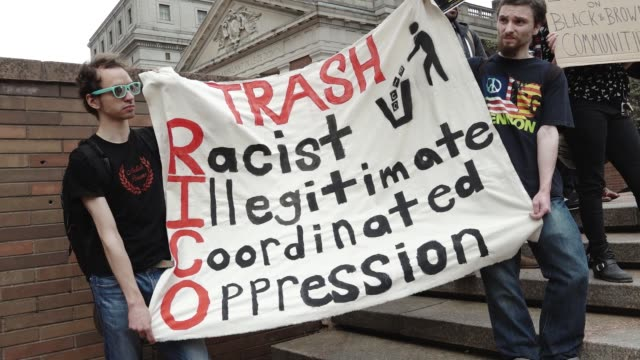 """vídeos de stock, filmes e b-roll de family members and grassroots community groups rallied and marched against nypd and federal """"gang"""" raids. the raids are devastating communities of... - made in the usa frase americana"""