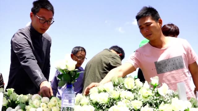 Family members of those who lost their lives in the plane crash near Addis Ababa on Sunday visit the site of the disaster to pay their respects and...