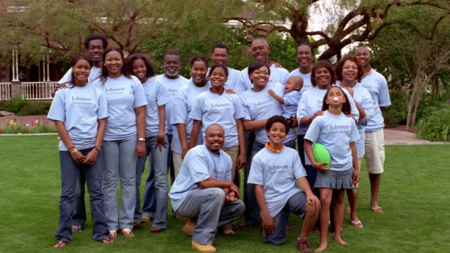 family members posing for camera in commemorative t-shirts at family reunion / mesa, arizona - family reunion stock videos and b-roll footage