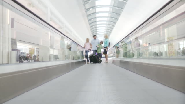 MS Family moving walkway in airport  / Jacksonville, FL, United States