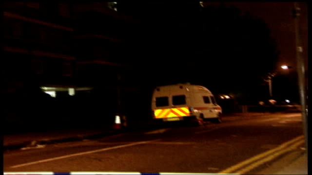 london bethnal green columbia road block of flats tilt down to police van below lms side police vehicles at scene - bethnal green stock videos & royalty-free footage
