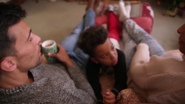 family near christmas tree - cosy stock videos & royalty-free footage