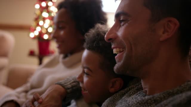 family near christmas tree - 30 39 years stock videos & royalty-free footage
