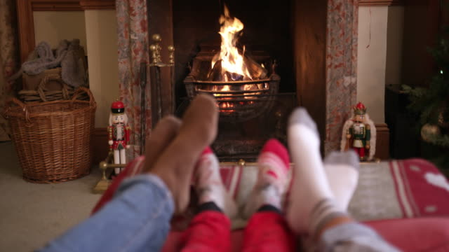 family near fireplace - domestic room stock videos & royalty-free footage