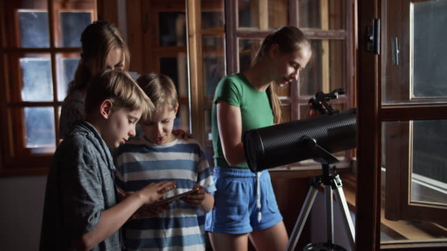 family observing the moon and the stars - astronomy telescope stock videos & royalty-free footage