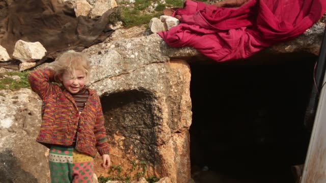 family of 20 people including elders and children who lost their home in air attacks in idlib, lives in cave near syrian-turkish border on barisha... - military exercise stock videos & royalty-free footage