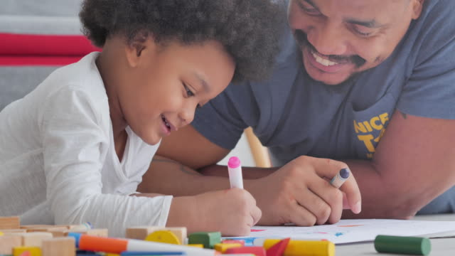 family of african father with little boy age 2-3 years old while homeschooling stay at home to prevent epidemics of coronavirus or covid-19.young parent father teaching school child boy helps studying at home.kids and crafts - 2 3 years stock videos & royalty-free footage