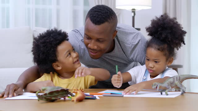 family of african father with little boy and girl age 2-3 years old while homeschooling stay at home to prevent epidemics of coronavirus or covid-19.young parent father teaching school children helps studying at home.families in south africa concept. - 2 3 years stock videos & royalty-free footage