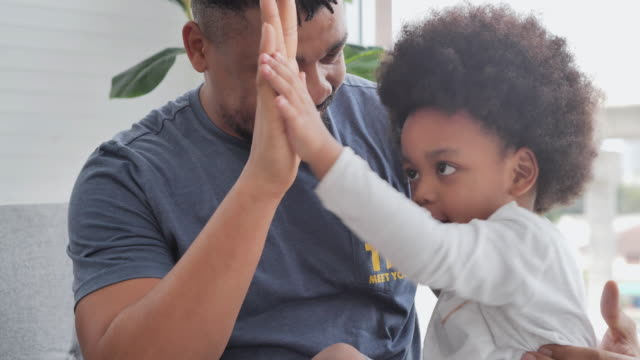 family of african father with little boy spending time together to kissing at home.dad and child tenderness moments.father, father's day, celebration, togetherness, bonding, admiration, love-emotion, family, single father - admiration stock videos & royalty-free footage