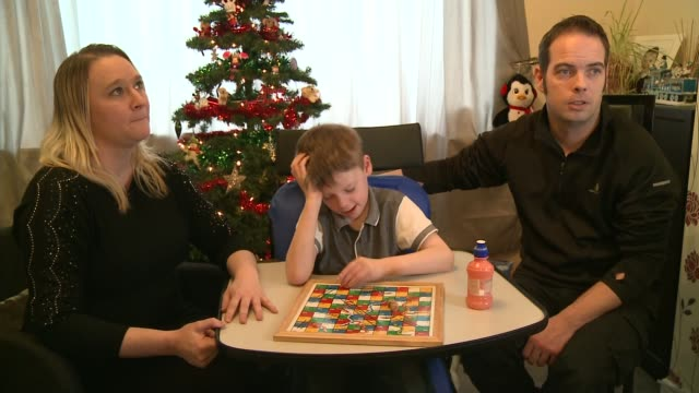 vídeos de stock, filmes e b-roll de family of boy with rare seizure condition raise money for us treatment close shot snakes and ladders board game susan box and james box interview sot... - condição