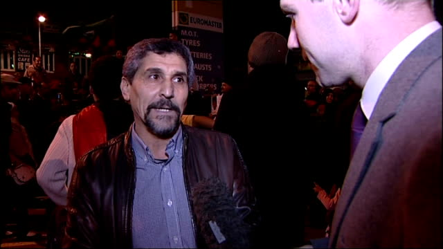 Family of British fighter talk of hearing of Gaddafi death Vox pops SOT Crowd of people gathered on the street celebrating