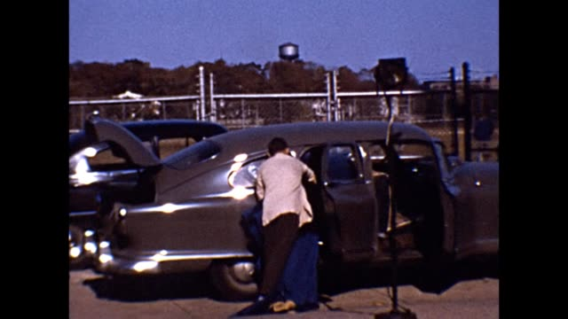 1953 Family of Entertainers Loading Car