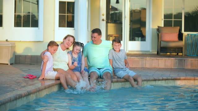 family of five at pool, girl with down syndrome - 10 11 years stock videos & royalty-free footage