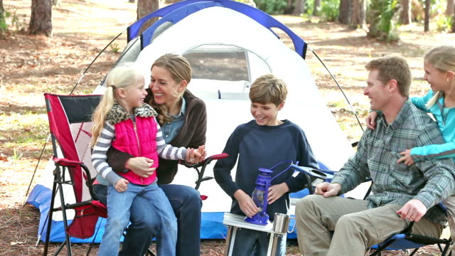 family of five camping, playing by tent - family with three children stock videos & royalty-free footage
