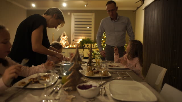 family of five during christmas dinner at home