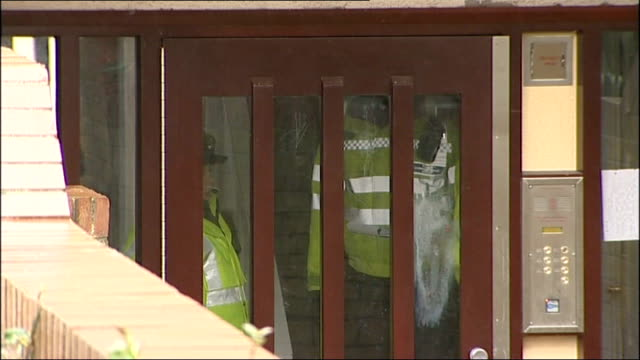 family of four found dead in leicester england leicestershire leicester ext general view block of flats where family lived police officers standing... - aquatic organism stock videos & royalty-free footage