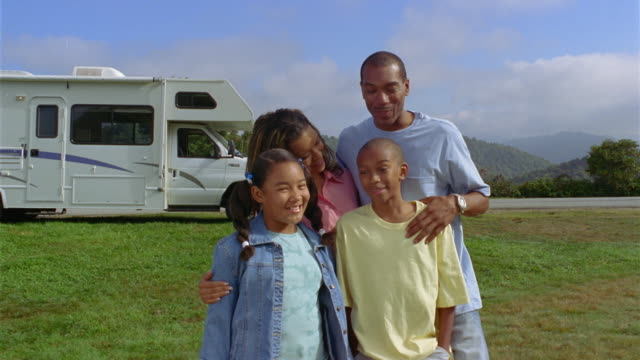 ms family of four smiling and posing in front of parked motor home / asheville, north carolina, usa - 12 13 jahre stock-videos und b-roll-filmmaterial