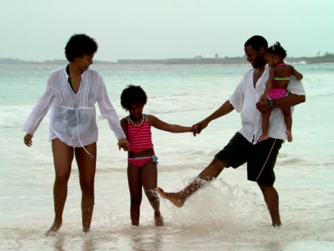 ms,  family of four walking on beach,  harbour island,  bahamas - baby girls stock videos & royalty-free footage