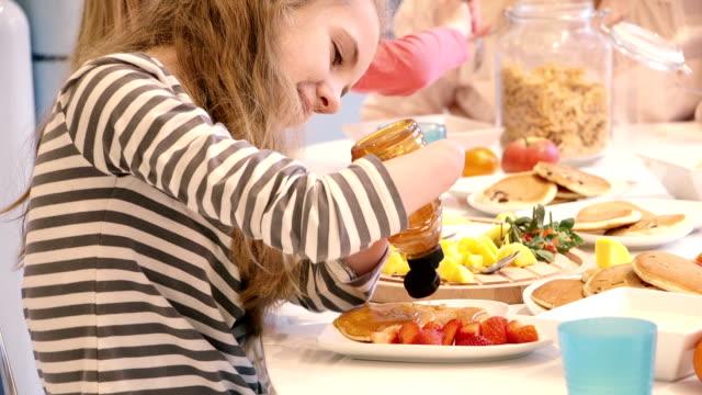 family of girls having a big breakfast - paraplegic stock videos & royalty-free footage