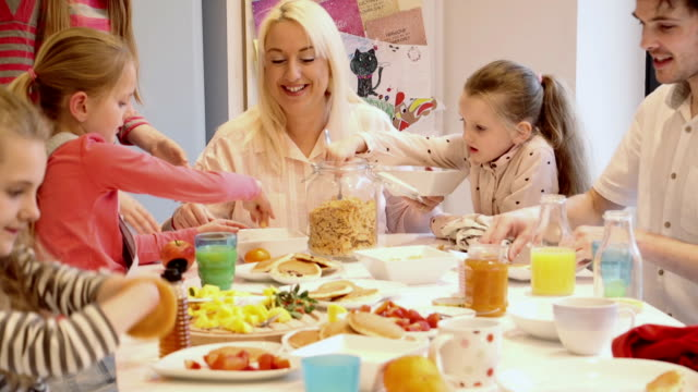 family of girls having breakfast! - physical disability stock videos & royalty-free footage