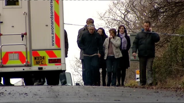 Family of Joanna Yeates visit spot where her body was found Cars and police vehicles parked in lane / David and Teresa Yeates Chris Yeates Greg...