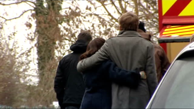 Family of Joanna Yeates visit spot where her body was found Family standing together at roadside and comforting one another before walking away down...