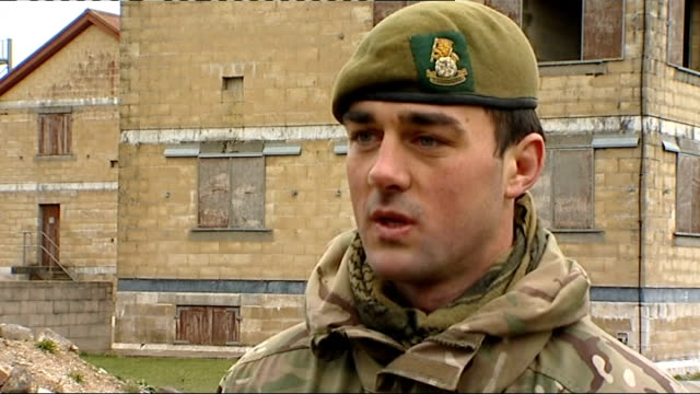 family of soldier killed in afghanistan pay tribute to him england wiltshire salisbury plain ext various shots of british troops / british soldiers... - military exercise stock videos and b-roll footage