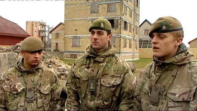 stockvideo's en b-roll-footage met family of soldier killed in afghanistan pay tribute to him; wiltshire: salisbury plain: ext various shots of british troops / british soldiers on... - british military