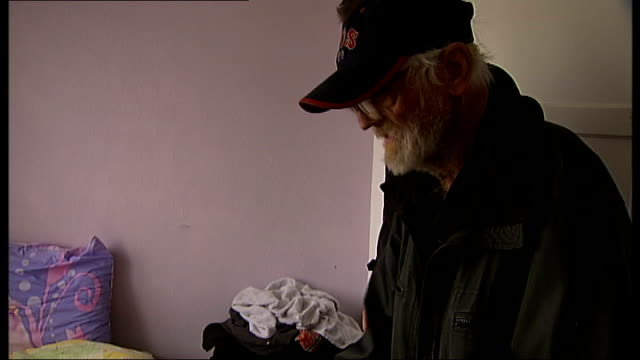 family of squatters move in to pensioner's home england london barking ext george pope speaking to reporter as showing how squatters changed locks on... - handle stock videos and b-roll footage