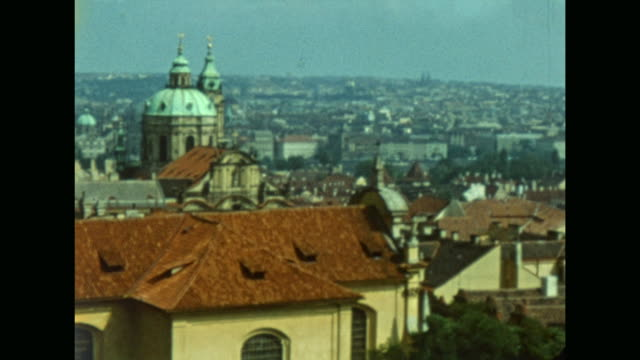 family of the gdr in holidays at prague cssr many cars parking prague castle many tourists entrance of the dome golden lane view over the roofs of... - フラッチャニ城点の映像素材/bロール