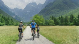 CS Family of three with a young son talking while starting their bike trip into the mountains