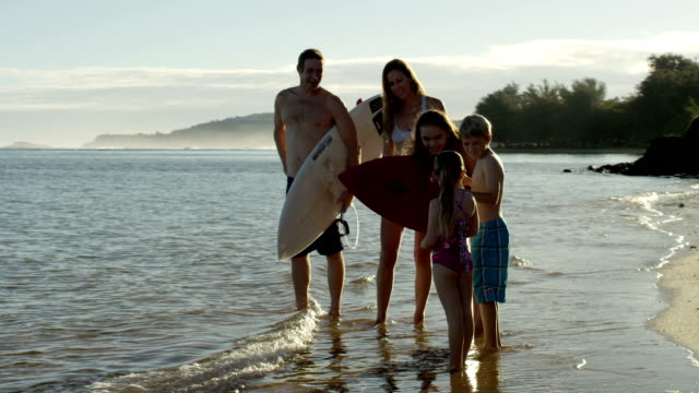 Family on a tropical beach vacation to Hawaii