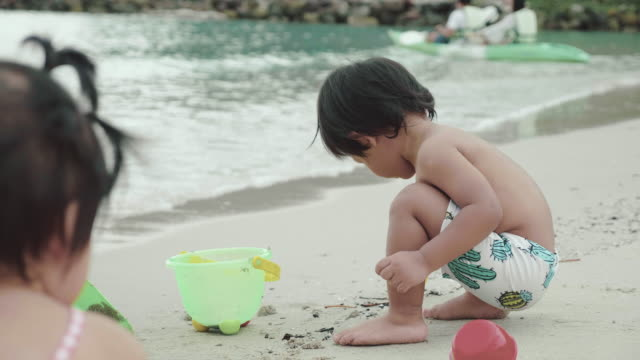 family on a tropical beach vacation to koh kood. - trat province stock videos and b-roll footage
