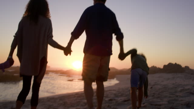 family on beach - four people stock videos & royalty-free footage