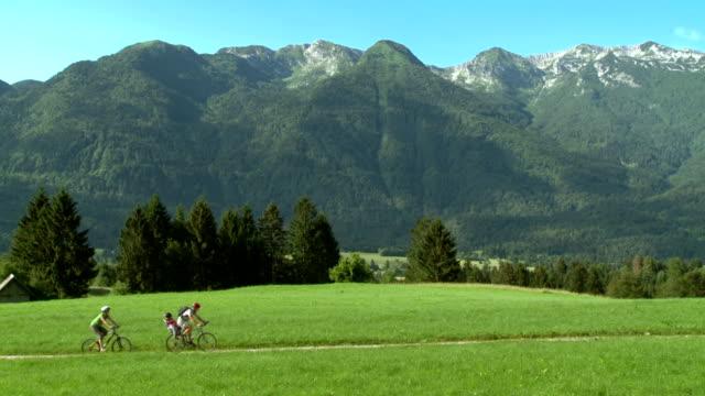 hd: family on bikes in julian alps - julian alps stock videos and b-roll footage