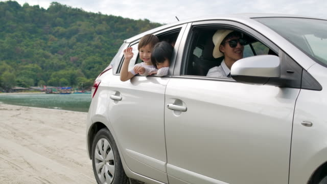 family on car at beach. - family convertible stock videos & royalty-free footage