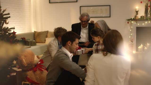 Family on christmas eve distributing presents