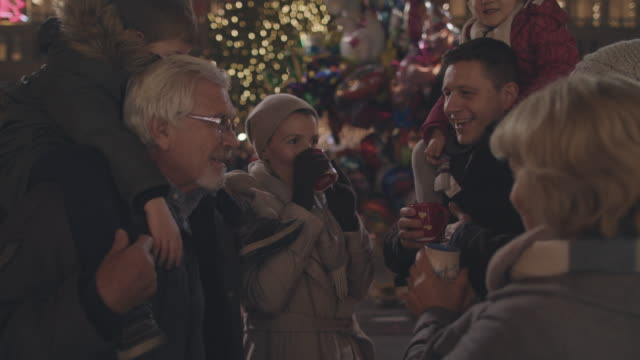 family on christmas market - grandfather stock videos & royalty-free footage