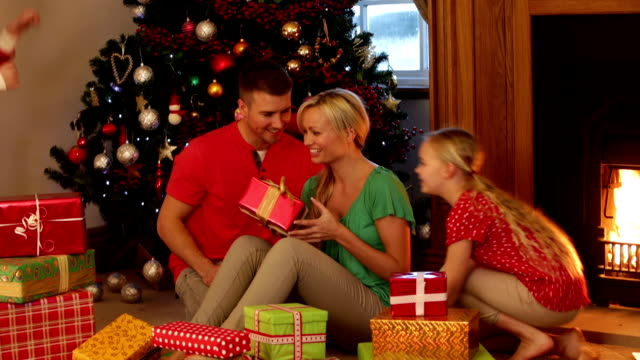 family on christmas morning - christmas gift stock videos & royalty-free footage