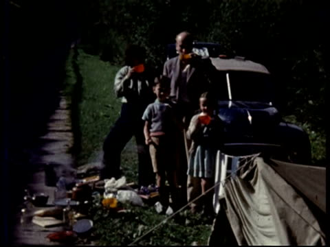 stockvideo's en b-roll-footage met 1950 family on holiday, camping in austria - 1955