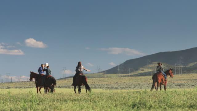 family on horseback riding away from camera - ranch family stock videos & royalty-free footage